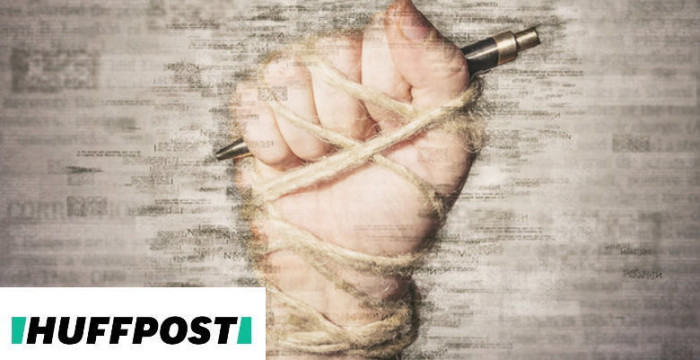 Hand with pen tied with rope, depicting the idea of freedom of the press or freedom of expression. Mixed media.